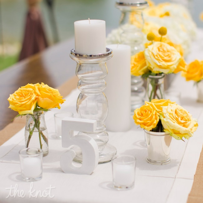 Tables were topped with white candles and runners for a fresh look.