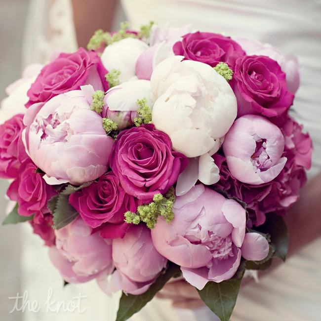 Julie carried a lush bouquet of pink peonies and roses.