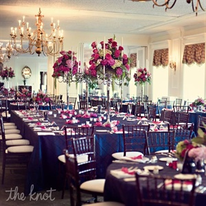 Navy pintuck linens, silver candleholders and lush magenta centerpieces decorated the tables.