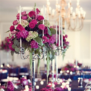 Tall candelabras were topped with pink roses, hydrangeas and candles.