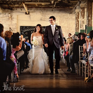 Andrew's classic charcoal-gray suit and silver tie complemented Shannon's whimsical gown.