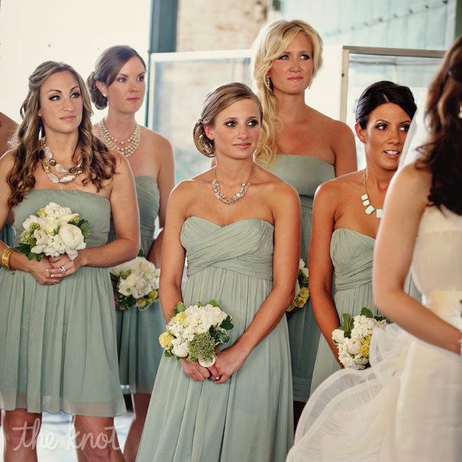 The bridesmaids chose their own dresses in a matching sage-green hue.