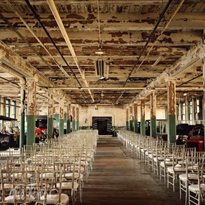 The couple exchanged vows on the second level of the historic car factory, with Model T's lining the space.