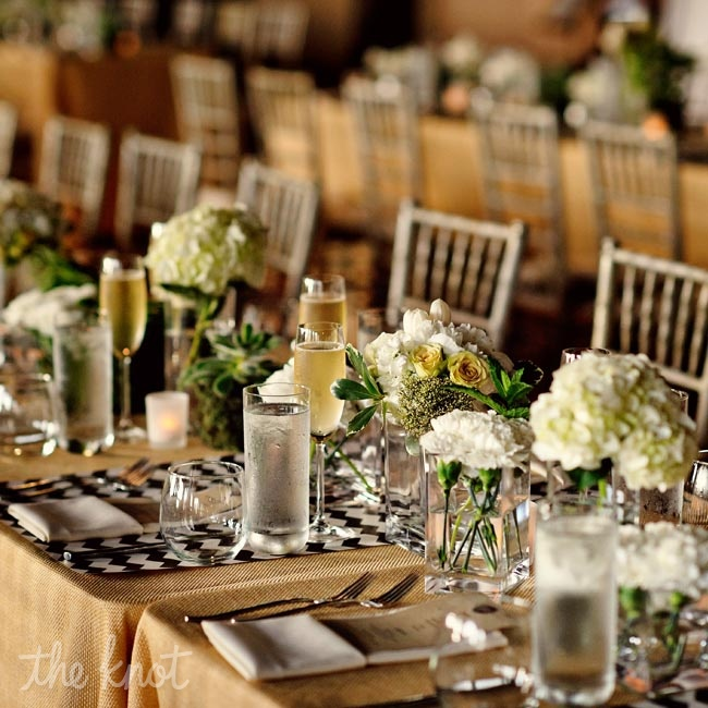 Faux-burlap linens and brown-and-ivory chevron runners echoed the rustic, deconstructed vibe of the space. Succulents, roses and hydrangeas added a fresh feel to the banquet tables.