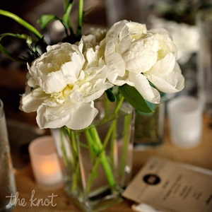 Low glass vases with white peonies added a clean, crisp feel to the neutral tablescapes.