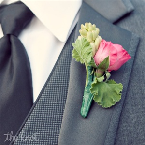 The groomsmen wore a pop of pink on their lapels.