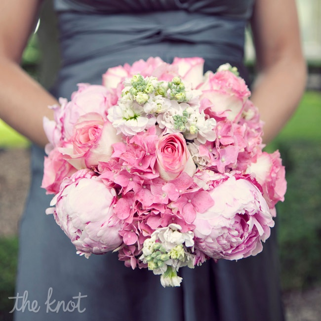 Big bunches of pink roses, hydrangeas and peonies popped against the girls' gray dresses.