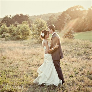 Stephanie wore a strapless ivory gown with ruching on the bodice, while Brett matched the day's colors in a charcoal-gray tux.