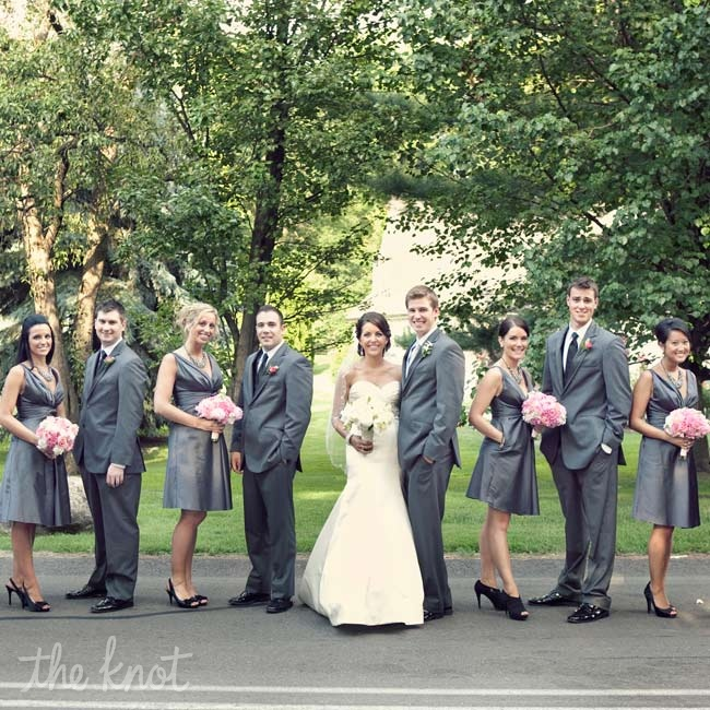 The bridesmaids' charcoal V-neck dresses coordinated with the groomsmen's gray tuxes and black ties.
