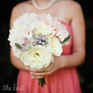 The bridesmaids carried fluffy bouquets of dahlias and roses.
