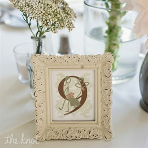 Playful table numbers were displayed in antique-looking frames.