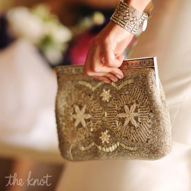 "For her ""something old,"" Kristen carried a beaded clutch that once belonged to her grandmother."