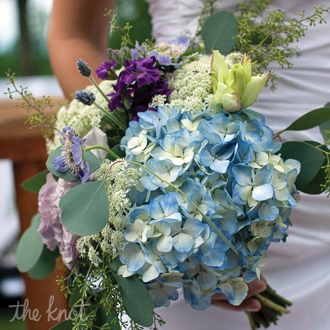 Pale-blue hydrangeas, purple lisianthus and stock made up Lilla's bouquet.