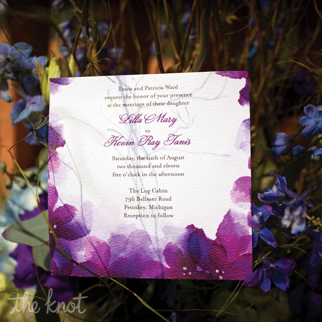 Purple watercolor flowers bordered the invitations.