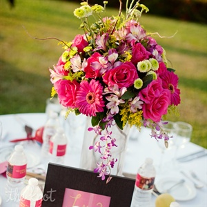 Tall centerpieces with magenta and green flowers decorated the guests' tables.