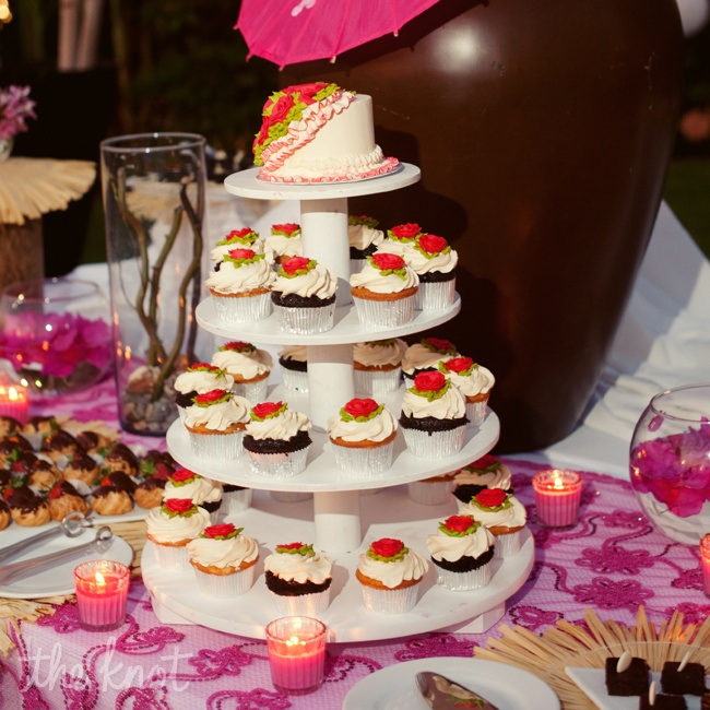 Instead of the traditional wedding cake they had cupcakes for their guests to take. The cake top was a gluten free cake for the bride and groom to enjoy.