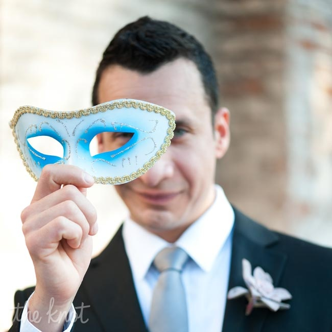 While most of the bride's family is from New Orleans, the groom's family and their friends are not. Their planned a wedding that was unique to the New Orleans culture including the Mardi gras masks they provided for their guests as favors.
