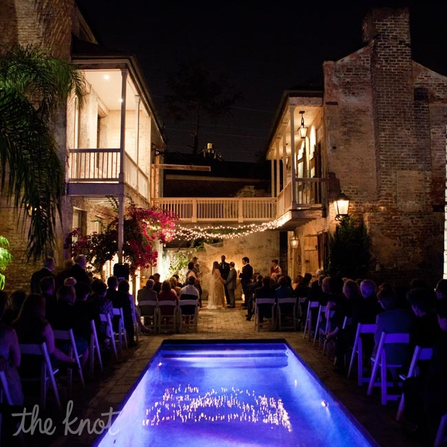 The courtyard was the perfect setting for Fidelma and Gabe's after sunset ceremony. They said their vows under twinkling lights with the pool as a beautiful centerpiece.