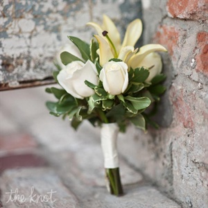 Fidelmas bridal bouquet, a combination of roses and lilies, were the perfect accent to her wedding gown.