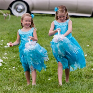 Lauren&#39;s mother made the flower girls beautiful fairy dresses with matching baskets. The girls are second cousins on her father&#39;s side.