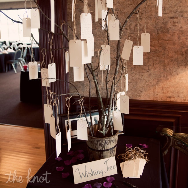 The couple opted to have a wishing tree instead of a traditional guest book so that their guests could write their wishes for them on pieces of paper. Jennifer said she's planning on framing all of the pieces together and hanging it in a special place.