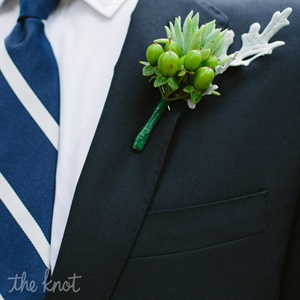 Adrian and all the groomsmen wore green berry and succulent boutonnieres.