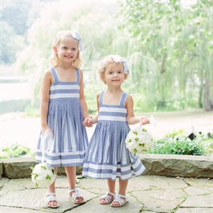 Erica&#39;s brother&#39;s daughters wore blue and white dresses and carried white hydrangea and berry pomanders.