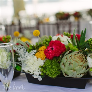 Artichokes, succulents, billy balls, hydrangeas and hypericum berries made up the fresh centerpiece arrangements.