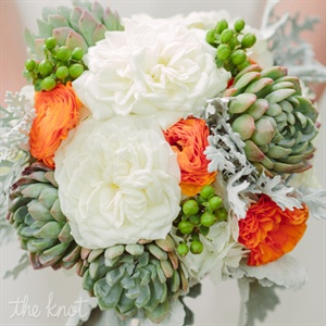 Erica carried a ruffled bunch of white garden roses, succulents, orange ranunculus and mini white hydrangeas.