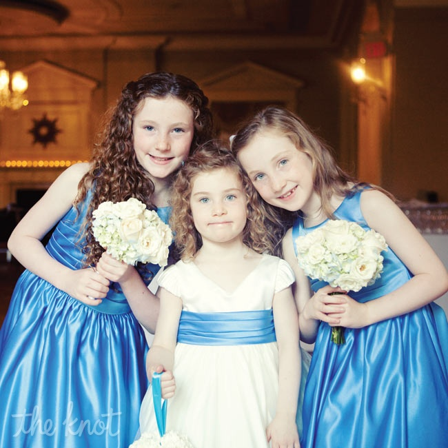 Tara's niece wore a blue and white dress to match the bridesmaid looks.