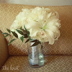 Tara carried an elegant white bouquet of lilies, peonies and ranunculus.