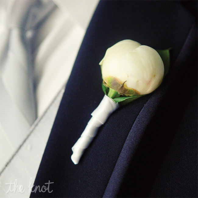 All the guys wore elegant closed ranunculus blooms on their lapels.
