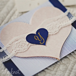 The couple design and sewed each invitation suite with ribbon lace.