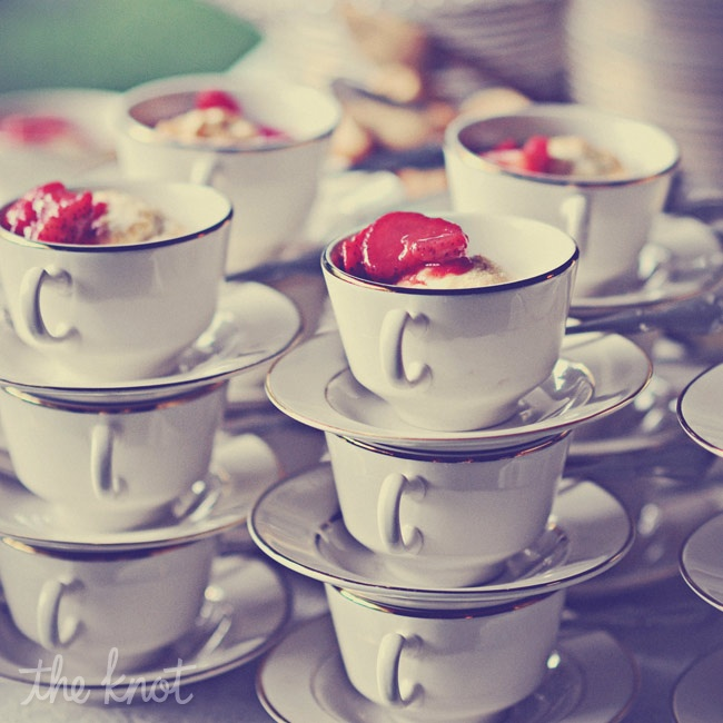 Strawberry shortcake with lemon curd and fresh whipped cream was served in tea cups with saucers.
