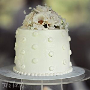For the cake cutting, the couple chose a small frosted red velvet cake.