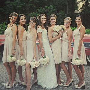 All the bridesmaids wore short blush and nude chiffon dresses. They wore matching nude wedges and coordinating jewelry Jessica gifted them.