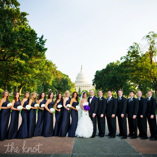 Raquel had ten bridesmaids who all wore Amsale, one strap shoulder, full length dresses in midnight purple. The Maid of honor, wore a strapless gown that set her apart. The eight groomsmen wore classic tuxedos from Men's Wearhouse.