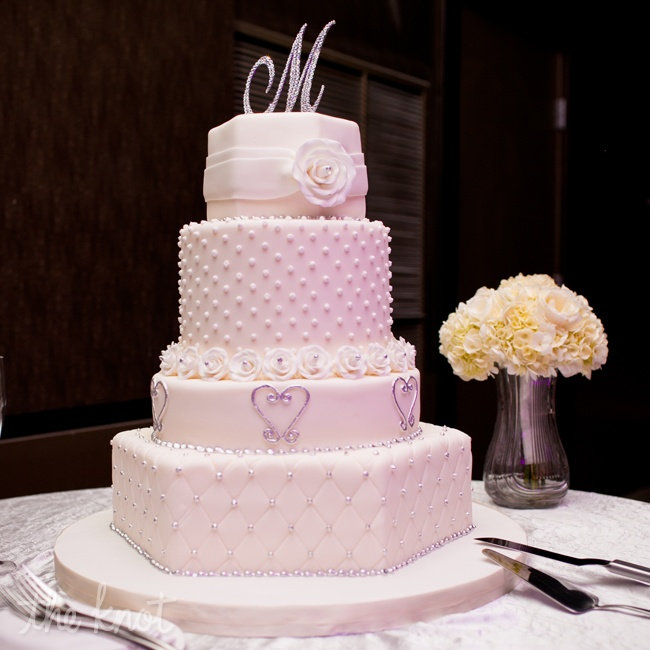 They chose a four layer buttercream cake in white with silver accents for an old Hollywood glam look.