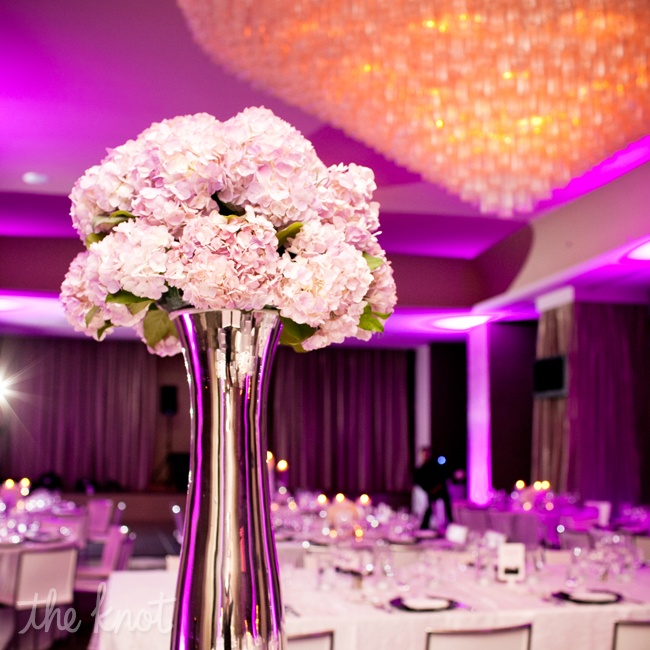 Tall silver vase centerpieces with lavender hydrangeas were one of the three centerpieces displayed at the reception.
