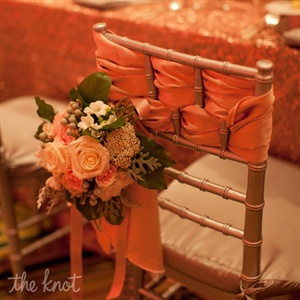Flowers and fabric decorated the bride and grooms' chairs at the reception.