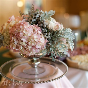 Hydrangeas, berries and greens filled silver urns at the cocktail hour.