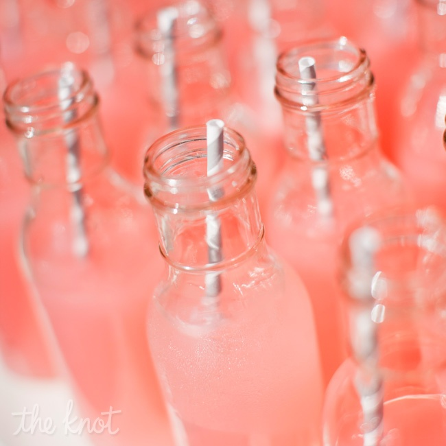 After the ceremony was over, guests sipped on pink lemonade from vintage bottles.