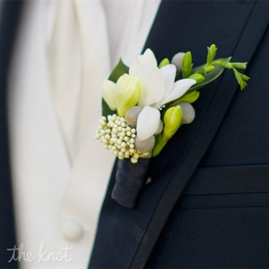Scott's boutonniere contained white freesia and rice flower to coordinate with Kaitlin's bouquet.
