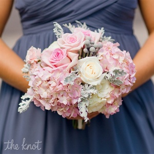 The bridesmaids carried pale pink roses, hydrangeas and silver brunia to complement their pewter Bill Levkoff dresses.