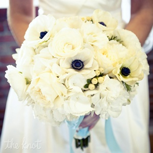 Missy carried an all-white bunch of hydrangeas, anemones, ranunculus, berries and garden roses.