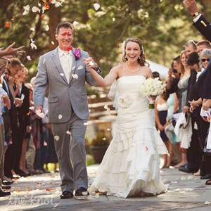 Guests tossed pink rose petals at the newlyweds as they exited the ceremony.