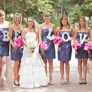 The bridesmaids wore navy blue bridesmaid dresses.