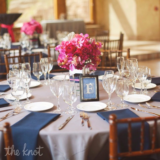 Silver table cloths were topped with navy napkins and vibrant fuchsia centerpieces.