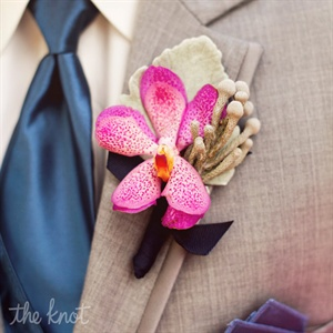 It was actually Jon's idea to wear orchid boutonnieres. All the guys wore fuchsia blooms backed with lamb's ear leaves.