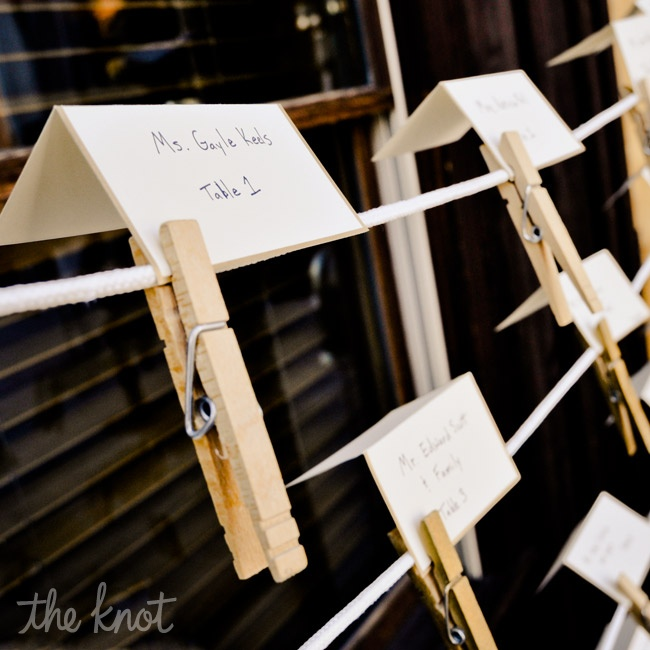 The white tented escort cards were displayed with clothespins.